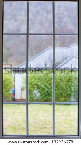 Window view garden - stock photo