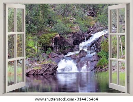 Window view to small mountain rapids falling into the lake - stock photo