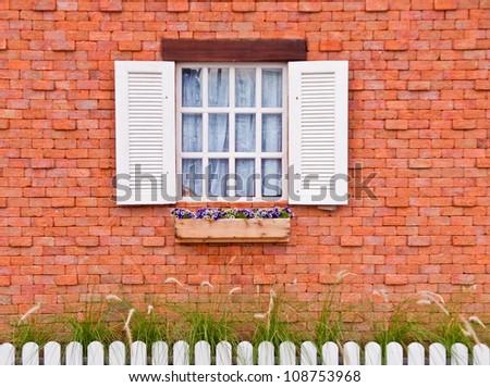 Window white on orange wall. - stock photo