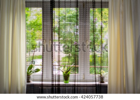 window with a curtain design - stock photo