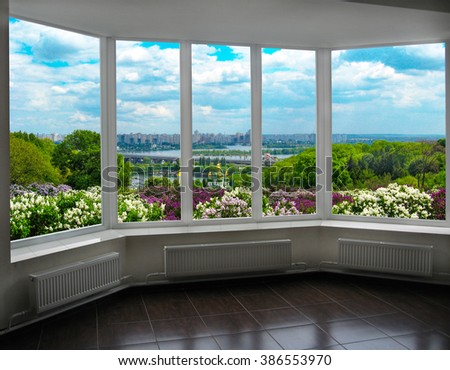 window with beautiful view of Kyiv in spring with bushes of lilac. Kyiv is the capital of Ukraine
