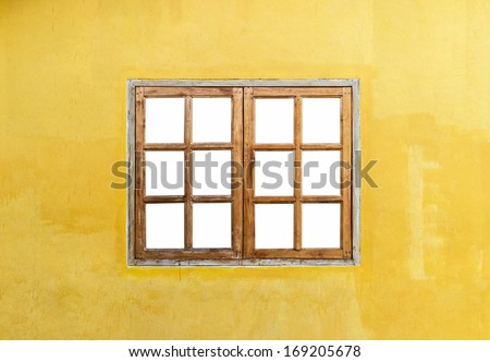 window with blank  and yellow wall - stock photo
