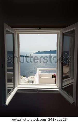 Window with caldera view in Santorini hotel - stock photo