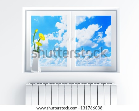 window with cloudy sky and flowers on sill - stock photo