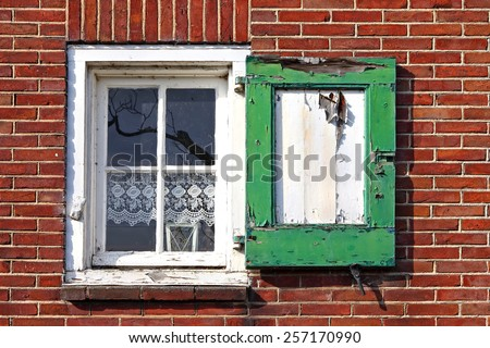 Window with curtains and shutters. Europe - stock photo