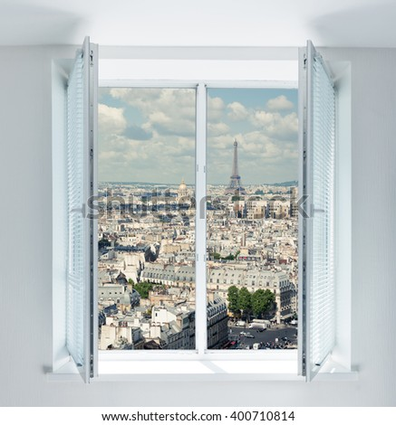 Window with Eiffel tower and roofs view - stock photo