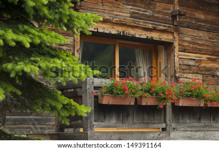 Window with flower box in France - stock photo