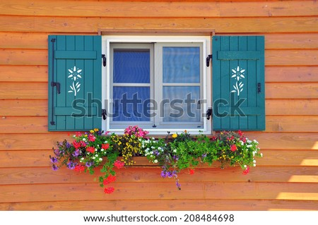 Window with flowers in italian house, Dolomites Alps - stock photo