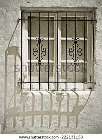Window with Ornamental Metal Lattice Sepia Toned Vintage Abstract - stock photo