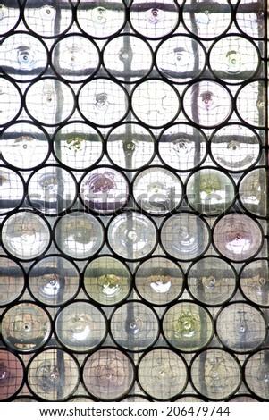 Window with reinforced glass and decorative metal net - stock photo