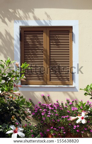 window with shutter in beautiful flowers- Crete, Greece