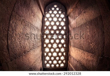 Window with sunglow in Qutub Minar complex in Delhi, India - stock photo