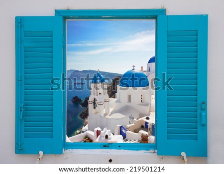 window with view of caldera and classical church with blue domes , Oia, Santorini, Greece - stock photo