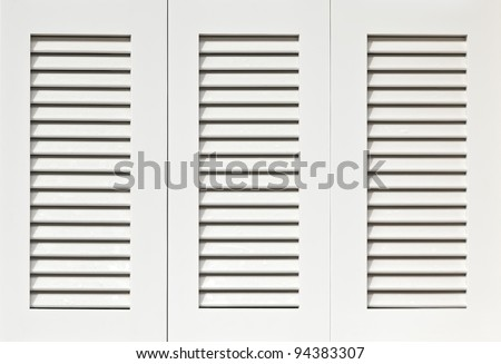 Window with white wooden shutters - stock photo
