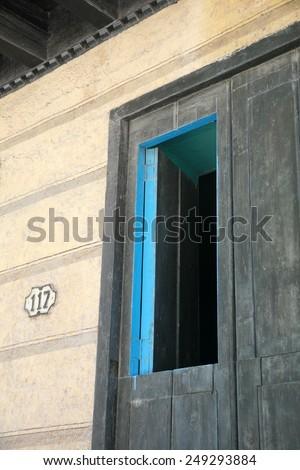Window within a door in Old Havana - stock photo