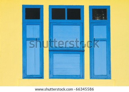 Window, yellow and blue of a beautiful building in Thailand - stock photo