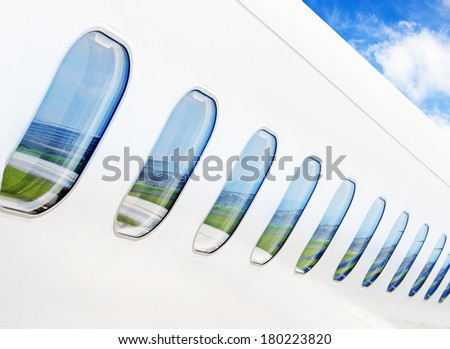 Windows airplane on blue sky background - stock photo