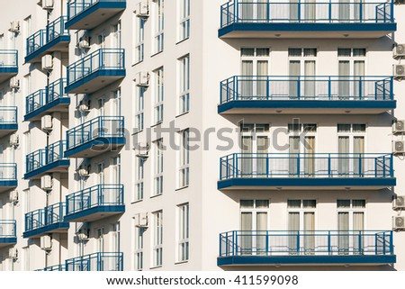 Windows and balconies of the new townhouse. - stock photo