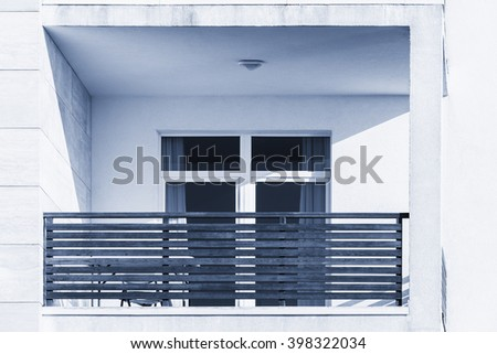 Windows and balconies of the new townhouse at sunset time. - stock photo