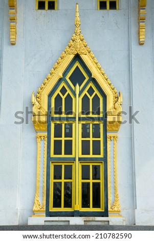 Windows and wall with garden decoration in wat Sothon Wararam Worawihan, the landmark of Chachoengsao province, Thailand  - stock photo