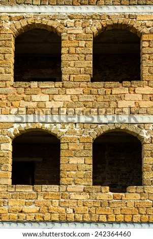 Windows and walls of an unfinished abandoned house - stock photo