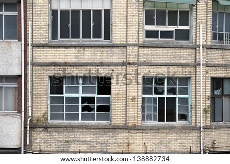Windows and walls of the old building - stock photo