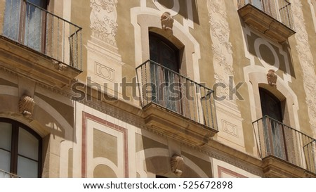 Windows, balconys and wall paintings on buildings in Montserrat near Barcelona, Catalonia, Spain, July 2016