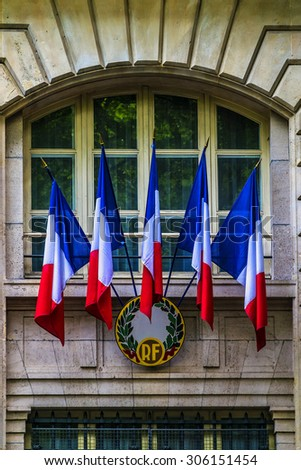 Windows decorated with the flags of France. Paris. - stock photo