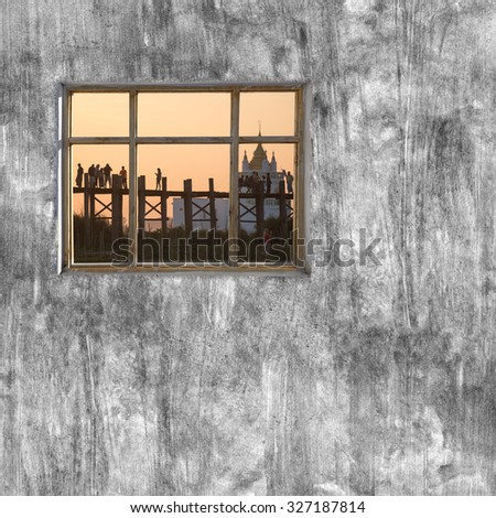 windows frame on cement wall and view of Mandalay, Myanmar