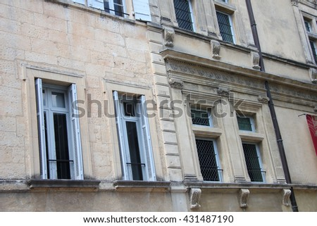 Windows in Provencal style with wooden painted shutters