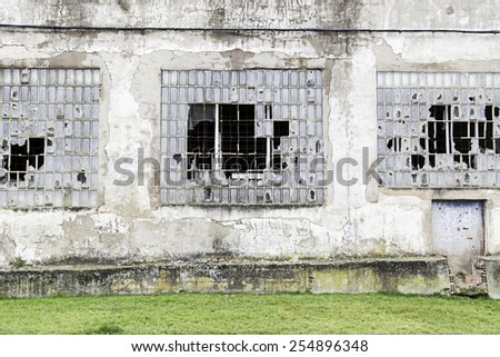 Windows of a building in ruins, detail of an abandoned building, crime and vandalism - stock photo