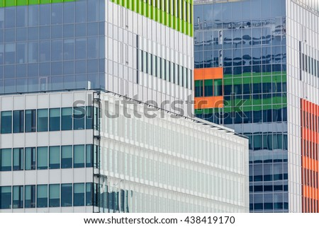 Windows of a modern business building exterior. Horizontal image of abstract modern building background for design with colorful windows. - stock photo