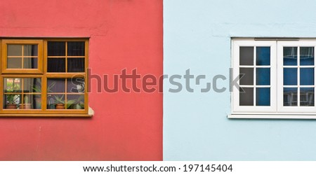 Windows of adjoining properties with striking colours - stock photo