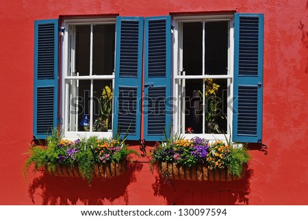 Windows of Charleston, SC show the tradition, beauty, color, and history of the historic city.