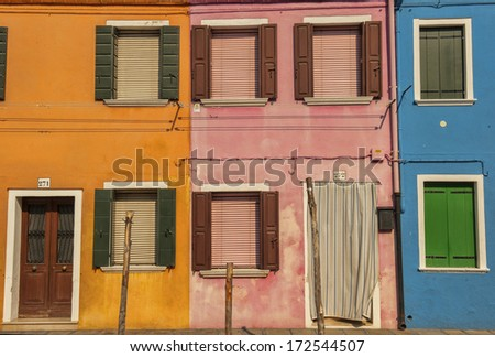 windows of colorful houses in Burano, Venice, Italy