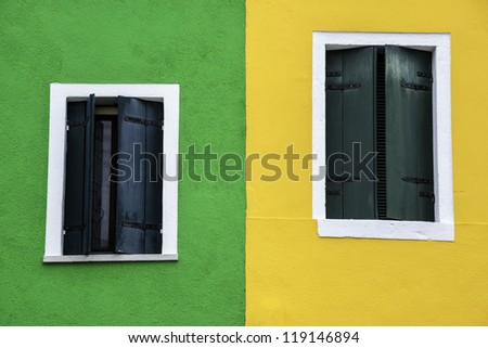 Windows of one of the colored houses in Burano - Venice - Italy - stock photo