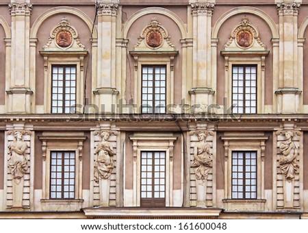 Windows of Stockholm Royal Palace (Kungliga slottet) in old town (Gamla stan), Stockholm, Sweden - stock photo