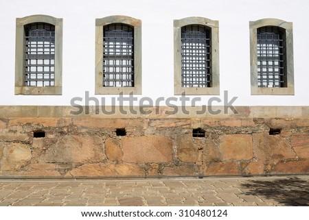 Windows of the Ancient Public Jail - Historic Town of Tiradentes (UNESCO World Heritage) - Minas Gerais, Brazil - stock photo