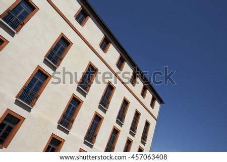 Windows on a facade of a stylish French facade - stock photo