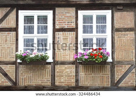 Windows on a half-timbered house in Quedlinburg town, Germany - stock photo