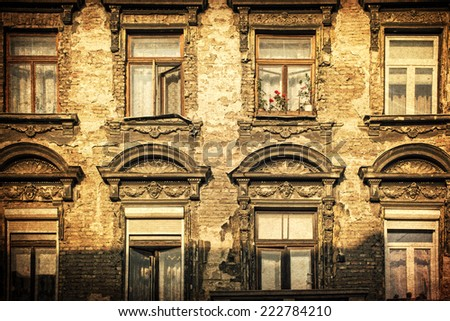 Windows on an old building on grungy background - stock photo