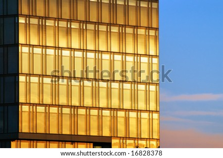 Windows on office building at sunset - stock photo