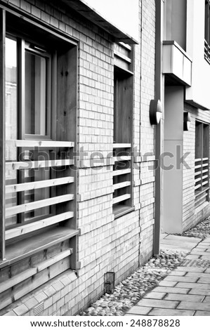 Windows on the outside of a new build apartment - stock photo