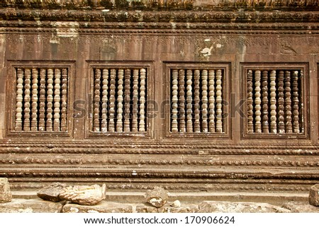 Windows relief of famous Angkor Wat temple complex, near Siem Reap, Cambodia. - stock photo