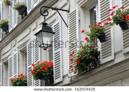 Windows with shutters of old buildings on Montmartre, Paris. - stock photo
