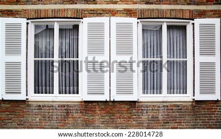 Windows with white shutters, Germany