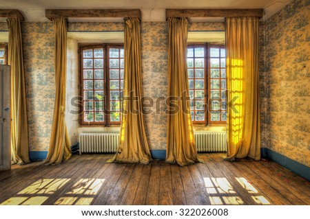 Windows with yellow curtains in an abandoned castle, HDR processing - stock photo