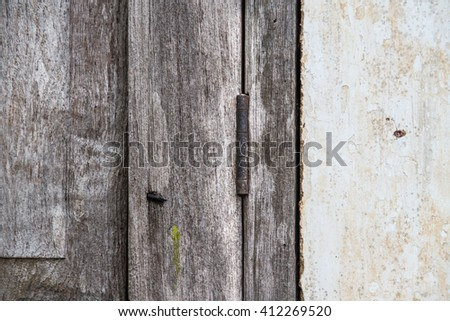 Windowsill Vintage image of old closed wooden  - stock photo