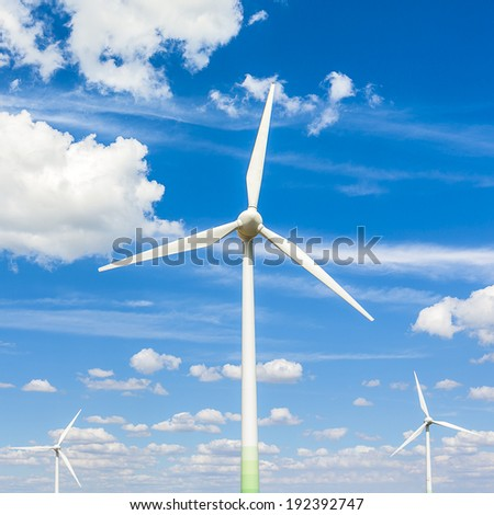 windpark windturbines windpower Alternative Energy with blue cloudy sky