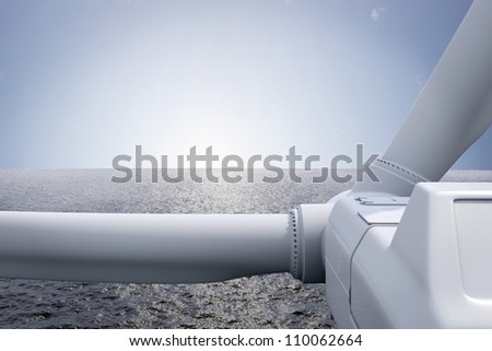 Windpark with ocean and sun over the horizon - stock photo